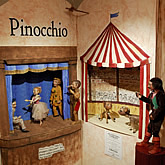 Photo of puppets from a production of Pinochio on display at the Ballard Institute and Museum of Puppetry