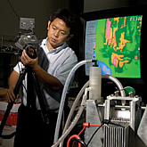 Photo of faculty member conducting fuel cell research