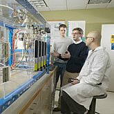 Photo of students and faculty working at UConn's state-of-the-art Global Fuel Cell Center
