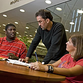 Photo of Mark Overmyer-Velazquez, assistant professor of history wroking with students