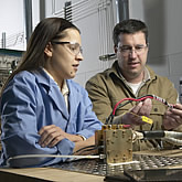 Photo of student and faculty working at UConn's state-of-the-art Global Fuel Cell Center