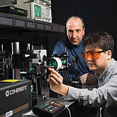 Photo of Photo of Bahram Javidi, a professor of electrical and systems engineering working with a student