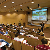 Photo of an art history class held in a large lecture hall at the Biology/Physics Building