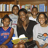 Swin Cash helps collect books for children